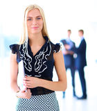 Young businesswoman holding a laptop, standing on office Royalty Free Stock Images