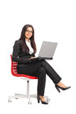 Young businesswoman holding a laptop Royalty Free Stock Image