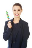 Young businesswoman holding a lolipop Royalty Free Stock Photography