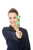 Young businesswoman holding a lolipop Royalty Free Stock Image