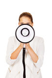 Young businesswoman holding megaphone Royalty Free Stock Images
