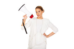 Young businesswoman holding megaphone Royalty Free Stock Image