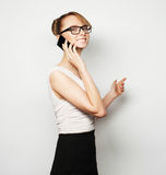Young businesswoman holding mobile phone Royalty Free Stock Photography