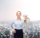 Young businesswoman holding money bags with euro Royalty Free Stock Photos