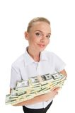 Young businesswoman holding money and smiling. Stock Image