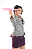Young businesswoman holding a paper plane Stock Photo