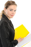 Young businesswoman holding a planner/folder Stock Photo