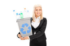 Young businesswoman holding a recycle bin Royalty Free Stock Photography