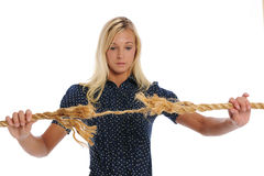 Young Businesswoman holding a rope Stock Image
