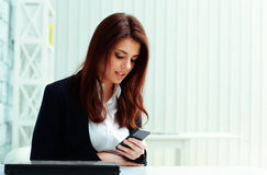 Young businesswoman holding smartphone Stock Images