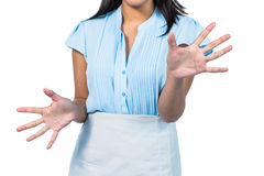 Young businesswoman holding something. Against white background Stock Images