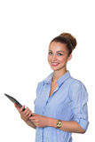 Young businesswoman holding the tablet with a list of tasks and working on touching screen, smiling at camera isolated on white ba Royalty Free Stock Photos