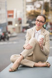 Young businesswoman holding take away coffee Stock Photography