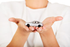 Young businesswoman holding a toy car Royalty Free Stock Images