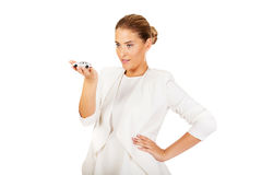 Young businesswoman holding a toy car Royalty Free Stock Image
