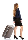 Young businesswoman holding travel bag Royalty Free Stock Photos