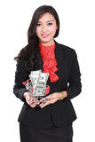 Young businesswoman holding trolley and money Stock Photography