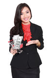 Young businesswoman holding trolley and money Royalty Free Stock Photography