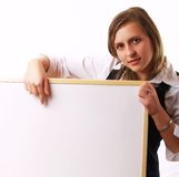 Young businesswoman holding a white board Stock Photography