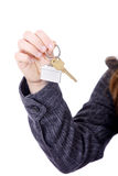Young businesswoman with house  keys. Young businesswoman (real estate agent) with house keys in hand Royalty Free Stock Photography
