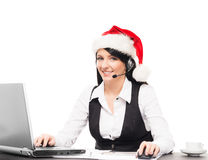 Young Businesswoman In A Christmas Hat In The Office Stock Photos