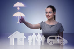 The young businesswoman in insurance concept Stock Images