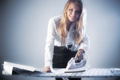 Young businesswoman iron paper documents Stock Photos