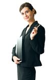 Young businesswoman, isolated. Young secretary or businesswoman with pen and folder Royalty Free Stock Photography