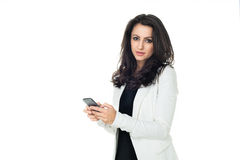 Young businesswoman isolated on white. Young businesswoman using phone isolated on white background Stock Photos