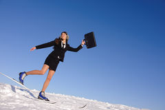 Young businesswoman jumping Stock Images