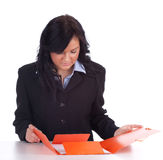 Young businesswoman keeping folder with documents Royalty Free Stock Images