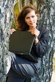 Young businesswoman with laptop. Royalty Free Stock Photos
