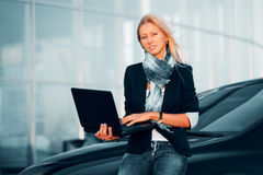 Young businesswoman with laptop Royalty Free Stock Photo