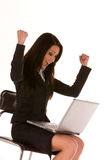 Young businesswoman at laptop with arms up Stock Photography