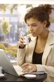 Young businesswoman with laptop and coffee Royalty Free Stock Photography