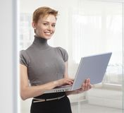 Young businesswoman with laptop computer at office Stock Image