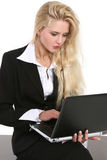 Young businesswoman with laptop isolated on white Stock Images
