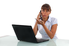 Young businesswoman with laptop. On the phone Stock Photography