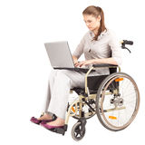 Young businesswoman with laptop on the wheelchair Stock Images