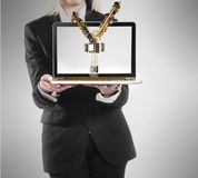 Young businesswoman with laptop and yen money sign in hand Royalty Free Stock Photos