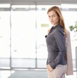 Young businesswoman leaving office Royalty Free Stock Images