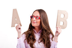 Young businesswoman with letters ab Stock Images