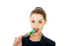 Young businesswoman licking a lolipop Stock Photography