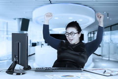 Young businesswoman lifting hands Stock Image