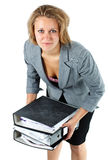 Young businesswoman lifting notepads Stock Photo