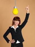 Young businesswoman, light bulb, having idea Stock Photos