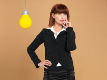 Young businesswoman with light bulb, thinking Stock Photo
