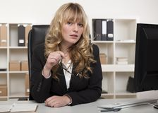 Young businesswoman listening carefully Stock Photography