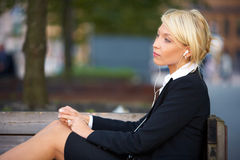 Young Businesswoman Listening Music Royalty Free Stock Images