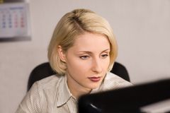 Young businesswoman look at the computer screen Royalty Free Stock Image